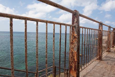 Rusty fence near the ocean