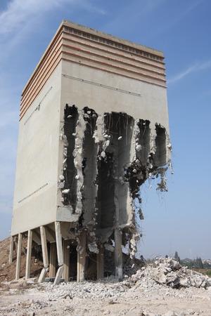 demolished: old flour silo building partly demolished
