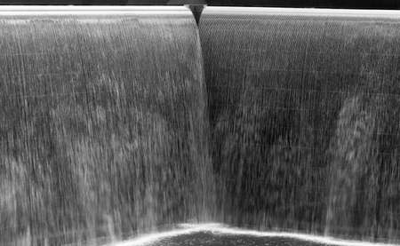 Flow of water in a big  fountain,  black and white