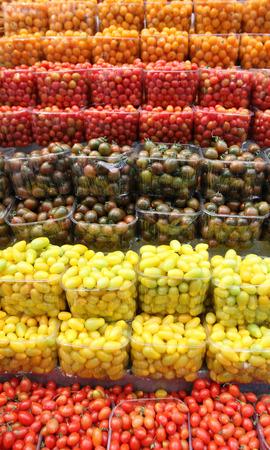 Fresh Cherry tomatoes piled iin the food market of Mahane Yehuda, Jerusalem Stock Photo