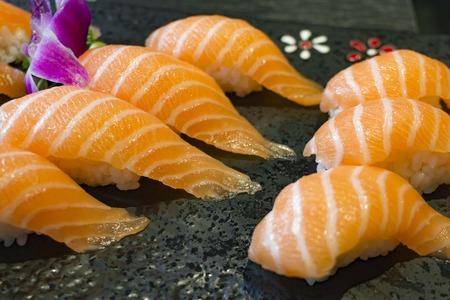 Sushi sake a black stone plate