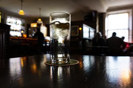 Glass on a dark irish pub.