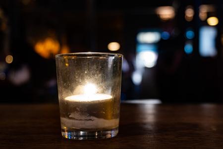 Candle in an irish pub Reklamní fotografie