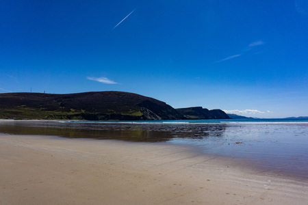 Holiday makers on Keel Beach enjoying the summer sun, Achill Island, County Mayo, Ireland Stock Photo