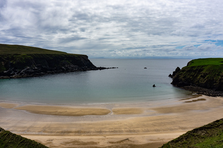 One of the most beautiful beaches of the Wild Atlantic Way is located near Malin Beg. The so-called Silver Beach is sheltered in a horseshoe-shaped bay. Reklamní fotografie