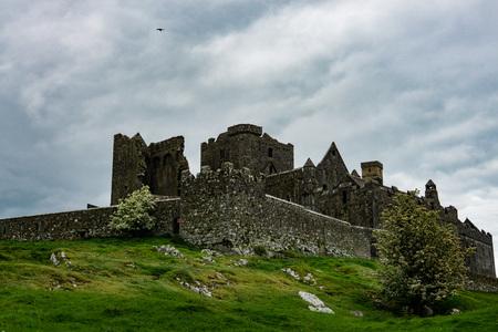Ireland, Cashel, May 2019: The iconic ruins of Rock of Cashel in Ireland