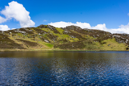 sunny day on lake near Slieve League cliffs in county Donegal, Ireland. Imagens