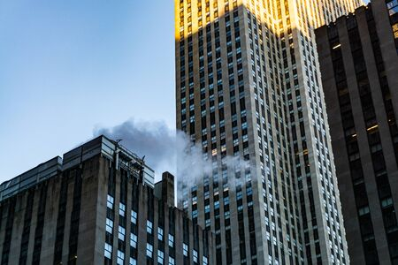 skyscraper buildings whit smoke shot from below in New York City
