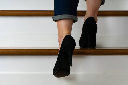 girl with heels on the stairs going up Banque d'images