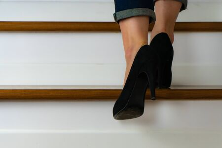 girl with heels on the stairs going up Stock fotó