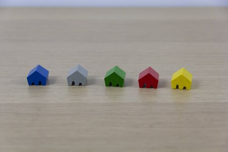 colored game pieces representing different houses, concept of choice and diversity
