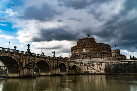 View of Tiber River, Castel Sant'Angelo (Castle of the Holy Angel) usually known as Mausoleum of Hadrian and Ponte Sant'Angelo (Aelian Bridge) in Rome, Italy