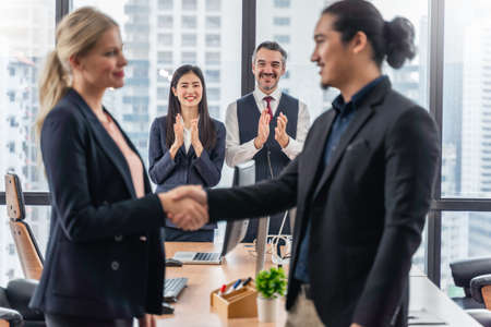 Businessmen and business woman shaking hands during a meeting with reach an agreement for business,Handshake Gesturing People Connection Deal Concept