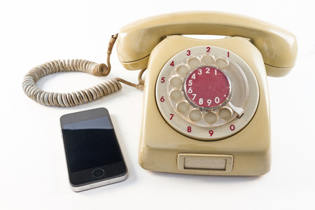 old telephone and smart phone on white background