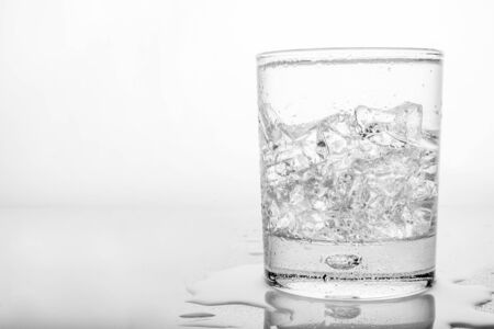 Glass of pure water with ice cubes. photo