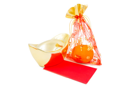 red packet: concept image of the chinese new year - Gold Ingot ,red packet and mandarin orange in the red auspicious bag Stock Photo