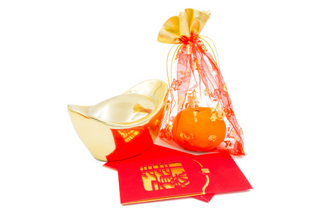 concept image of the chinese new year - Gold Ingot ,red packet and mandarin orange in the red auspicious bag photo