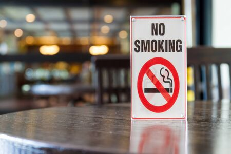 non: Signs of non smoking in restaurant .