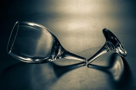 mirror on the water: broken wine glass Stock Photo