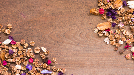 free space: Top view workspace with dried flowers on wooden table background .Free space for your text.
