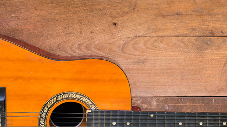 Top view workspace with acoustic guitar on wooden table background .Free space for your text. Stock Photo