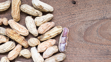 earthnut: Boiled Peanuts on wooden table background.