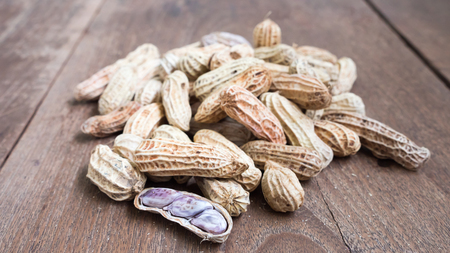 goober: Boiled Peanuts on wooden table background.Selective focus Stock Photo