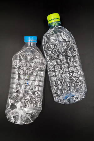 managing waste: Empty plastic bottles are recyclable waste.