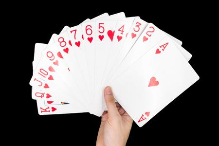 jack of diamonds: Hand holding Playing cards isolated on black background.