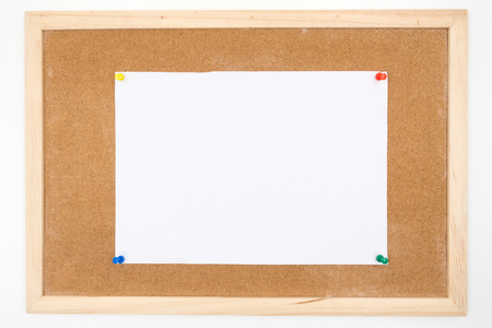 paper pin: Blank paper pin up on cork board. Stock Photo