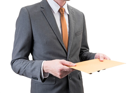 Businessman holding an envelope isolated on white background.