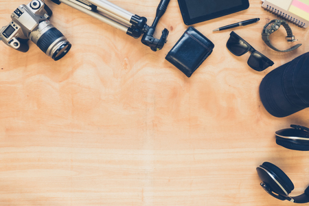 personal accessory: Top view of diverse personal accessory on the wooden table background.