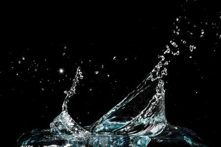 Water splash isolated on black background Imagens