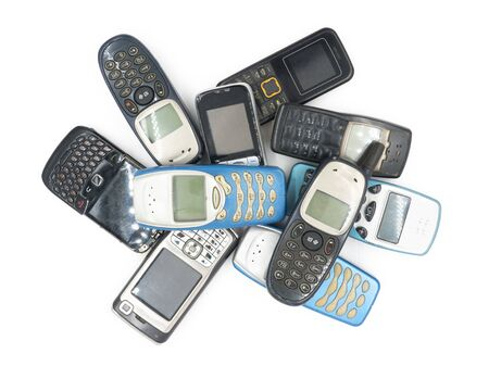 communicates: Top view of Old mobile phones on white background