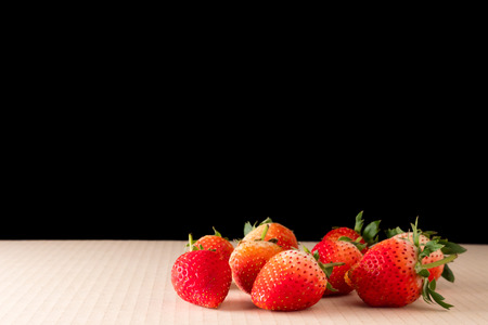 Strawberries on black background with copy space Stock Photo