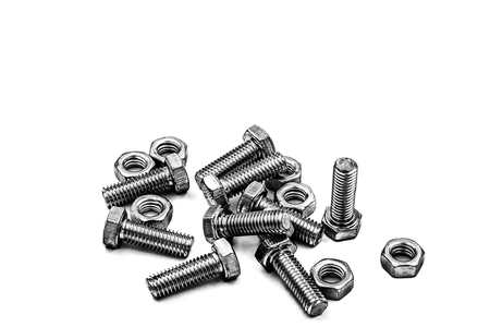 Bolts and nuts on white background. Stock Photo