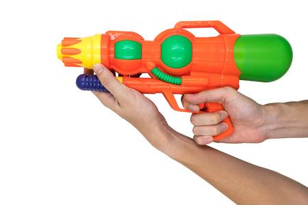 Hands holding Gun water toy on white background.