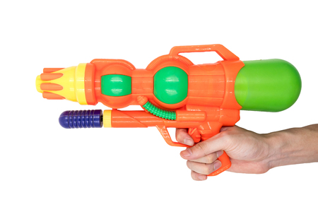 Hands holding gun water toy on white background. Stock Photo