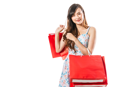 Beautiful happy woman with shopping bags on a white background.