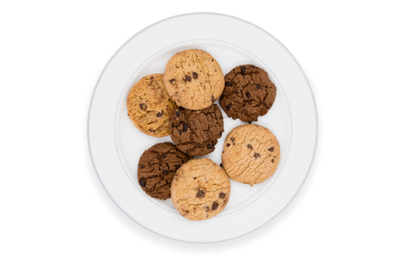 Chocolate chip cookies on plate on white background.