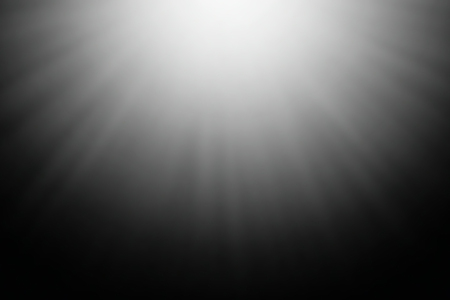 Blurred abstract light rays on a black background. Banco de Imagens
