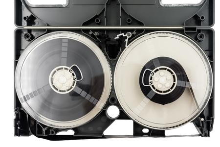 Open video cassette tape on white background.