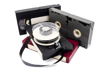 Video cassette tapes and reel on white background.