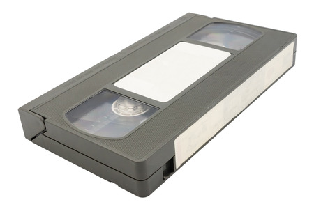 Old video cassette tape on white background. Stock Photo