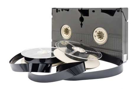Video cassette tape and reel on white background. Stock Photo