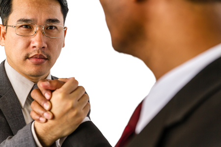 rival: Arm wrestling of business people isolated on white background. Stock Photo