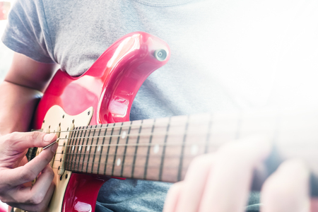 Close up of Male hands playing electric guitar, Flare from the sunlight, Selective focus Stock Photo - 80126583
