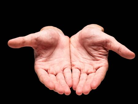 beg: Male hands on a black background.