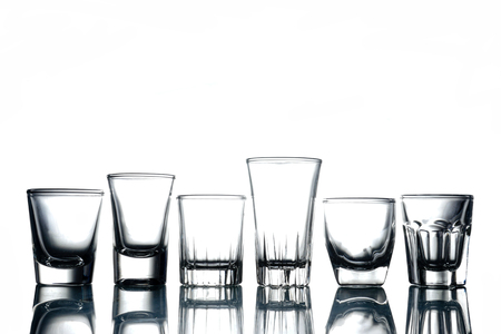 Collage of empty glasses on white background. Stock fotó