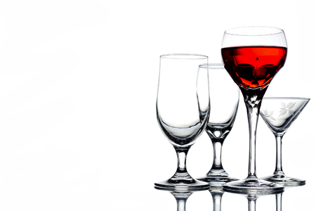 Collage of empty glasses with wine on white background. Free space for text